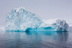 Iceberg floating along in Antarctica Stock Images