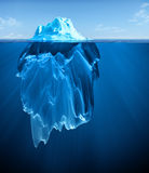 Iceberg. Floating on blue ocean