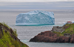 Iceberg floating by the coast Royalty Free Stock Images