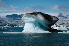 Iceberg floating in Jokulsarlon lagoon. ? south Iceland royalty free stock images