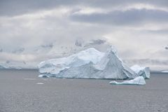 Iceberg floating offshore, Stock Image