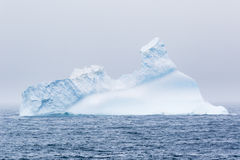 An iceberg floating in the sea Stock Photo