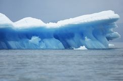 Iceberg floating on water Stock Image