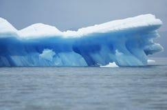 Iceberg floating on water Stock Image