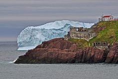 Iceberg and Fort Amherst. An iceberg in the sea near Fort Amherst in Newfoundland stock image