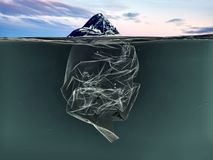 Iceberg of garbage plastic floating in ocean with greenland back royalty free stock image