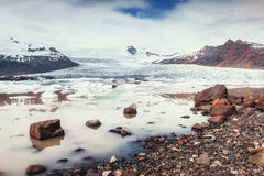 Iceberg Glacier Lagoon Fjallsarlon. Cumulus white clouds reflect Stock Image