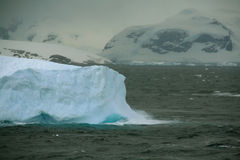 Iceberg glowing in an overcast dawn Royalty Free Stock Image