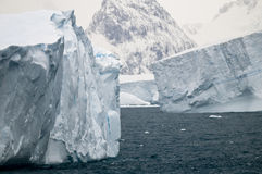 Iceberg Graveyard. A tight view of a group of large, grounded icebergs in the shallow seas around South Georgia stock photography
