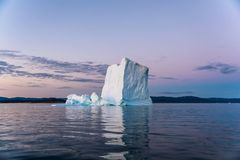 Iceberg in Greenland`s white night. royalty free stock images