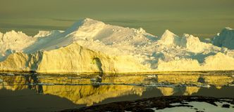Iceberg in Greenland during sunset. Golden Hour stock images