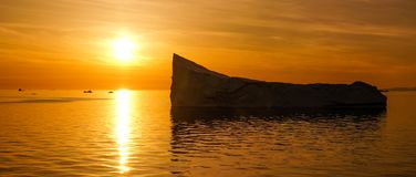 Iceberg in Greenland during sunset. Golden Hour royalty free stock photo