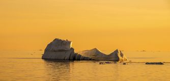 Iceberg in Greenland during sunset. Golden Hour royalty free stock photos