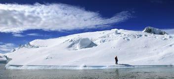 Iceberg Island. Iceberg with man standing in isolation, marooned Royalty Free Stock Photos