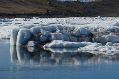 Iceberg in a lake showing some sediment on its side royalty free stock images