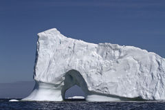 Iceberg with large through the entrance to the ocean off the coa Royalty Free Stock Photo