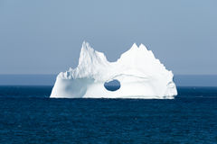 Iceberg with a Large Hole, Newfoundland Stock Photo
