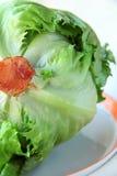 Iceberg lettuce. Green iceberg lettuce on a white plate Stock Photo