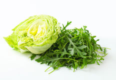Iceberg lettuce and arugula Stock Images