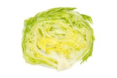 Iceberg lettuce half from above on white background. Crisphead. Fresh light green salad head. Sometimes called cabbage lettuce. Variety of Lactuca sativa royalty free stock photos