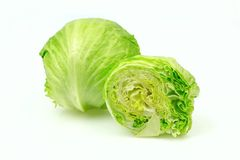 Iceberg lettuce and one cut half Royalty Free Stock Photo