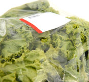 Iceberg lettuce in plastic bag package Stock Photo