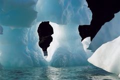 Iceberg Melting. Large blue iceberg melting Stock Image