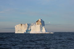 Iceberg and the Moon royalty free stock image