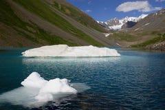 Iceberg in mountain loch. Jassylkol lake, Kyrgyzstan, 3500 m. altitude, june Stock Images