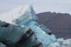 Iceberg and mountain Stock Image