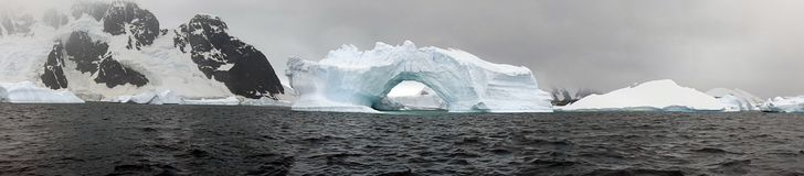 Iceberg and mountains in Antarctica stock photography