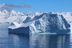 Iceberg and mountains in Antarctica stock photo