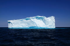 Iceberg near to the west coasts of Greenland. Newly born Iceberg. Piece 500 m long 10000 years old ice broken from glaciers or ice shelves in Western Greenland stock images