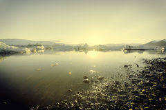 Iceberg no lago da geleira de Jokulsarlon no por do sol Fotos de Stock