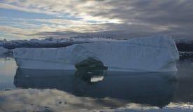 Iceberg in ocean. Scenic view of iceberg reflecting in ocean, Skjoldungen Fjord, Greenland Stock Photography