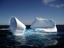 Iceberg in ocean stock images