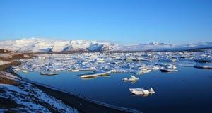 Iceberg reflection at sunrise at Jokulsarlon  in Iceland Royalty Free Stock Images