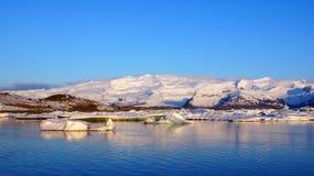 Iceberg reflection at sunrise at Jokulsarlon  in Iceland Royalty Free Stock Photography