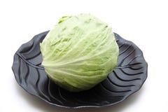 Iceberg salad on black plate Royalty Free Stock Image