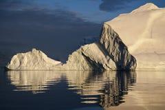 Iceberg in Scoresbysund - Greenland. Icebergs at dusk in Scoresbysund on the coast of Greenland Royalty Free Stock Image
