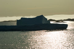 Iceberg in setting sun Royalty Free Stock Photography