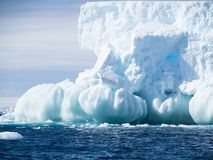 Iceberg with Spherical Foundation in the Southern Ocean. A large light blue iceberg with a foundation of spheres. The dark blue water of the Southern Ocean has