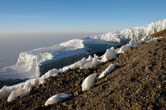Iceberg at the summit of mount Kilimanjaro. Glacier at the summit of the Kilimanjaro. This shot was taken early in the morning upon reaching to the summit of the stock photos