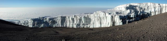 Iceberg at summit of mount Kilimanjaro panoramic. Panoramic view (stitched from many photos Stock Images