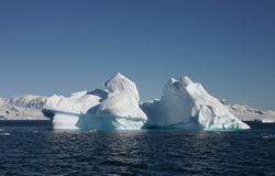 Iceberg in sunlight with landscape Stock Images
