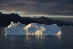 Iceberg sunset. Setting sun on Greenland iceberg Royalty Free Stock Images