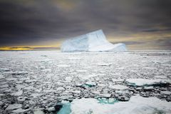 Iceberg during sunset. Blue colored iceberg during sunset in Antarctica Weddell Sea Stock Photography