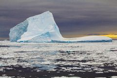 Iceberg during sunset. Blue colored iceberg during sunset in Antarctica Weddell Sea Royalty Free Stock Photography