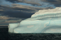 Iceberg with surrealistic blue Stock Image