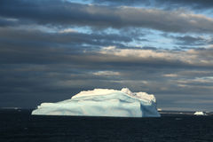 Iceberg with surrealistic blue Royalty Free Stock Image